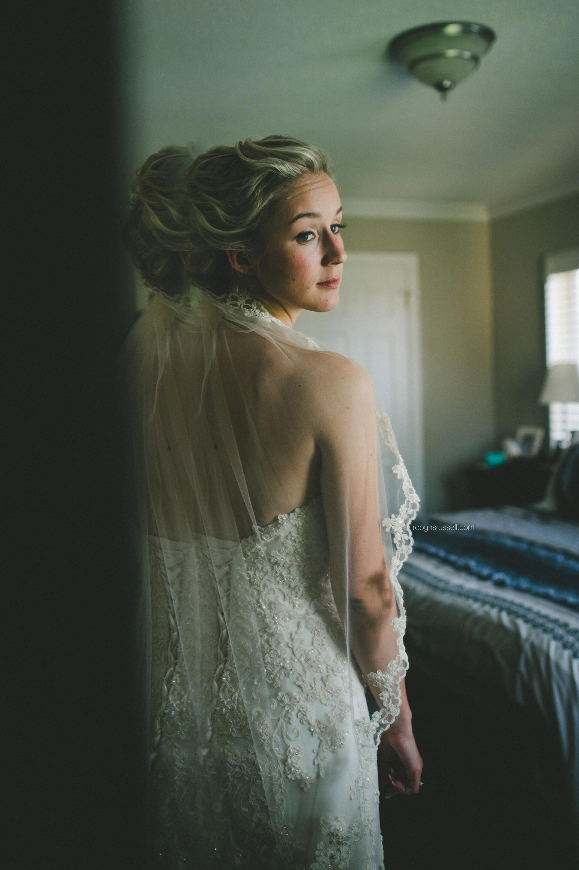 15-bride-looking-in-mirror-on-wedding-day.jpg