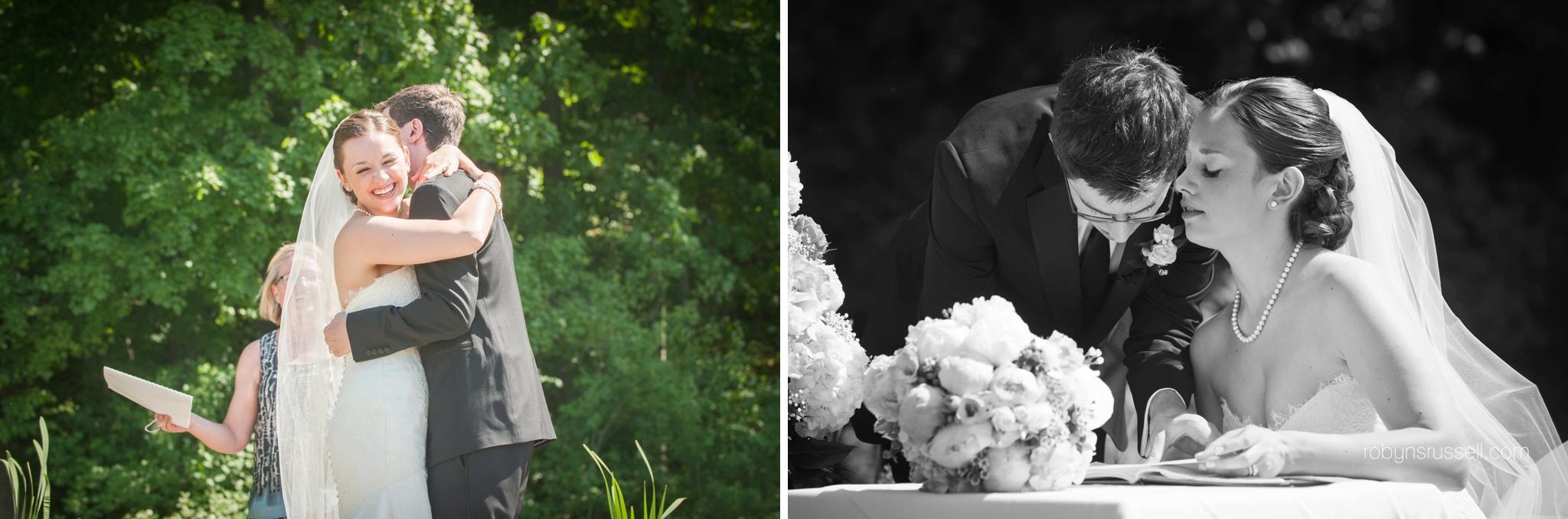 17-bride-and-groom-kiss-and-sign-registry-in-jordan.jpg