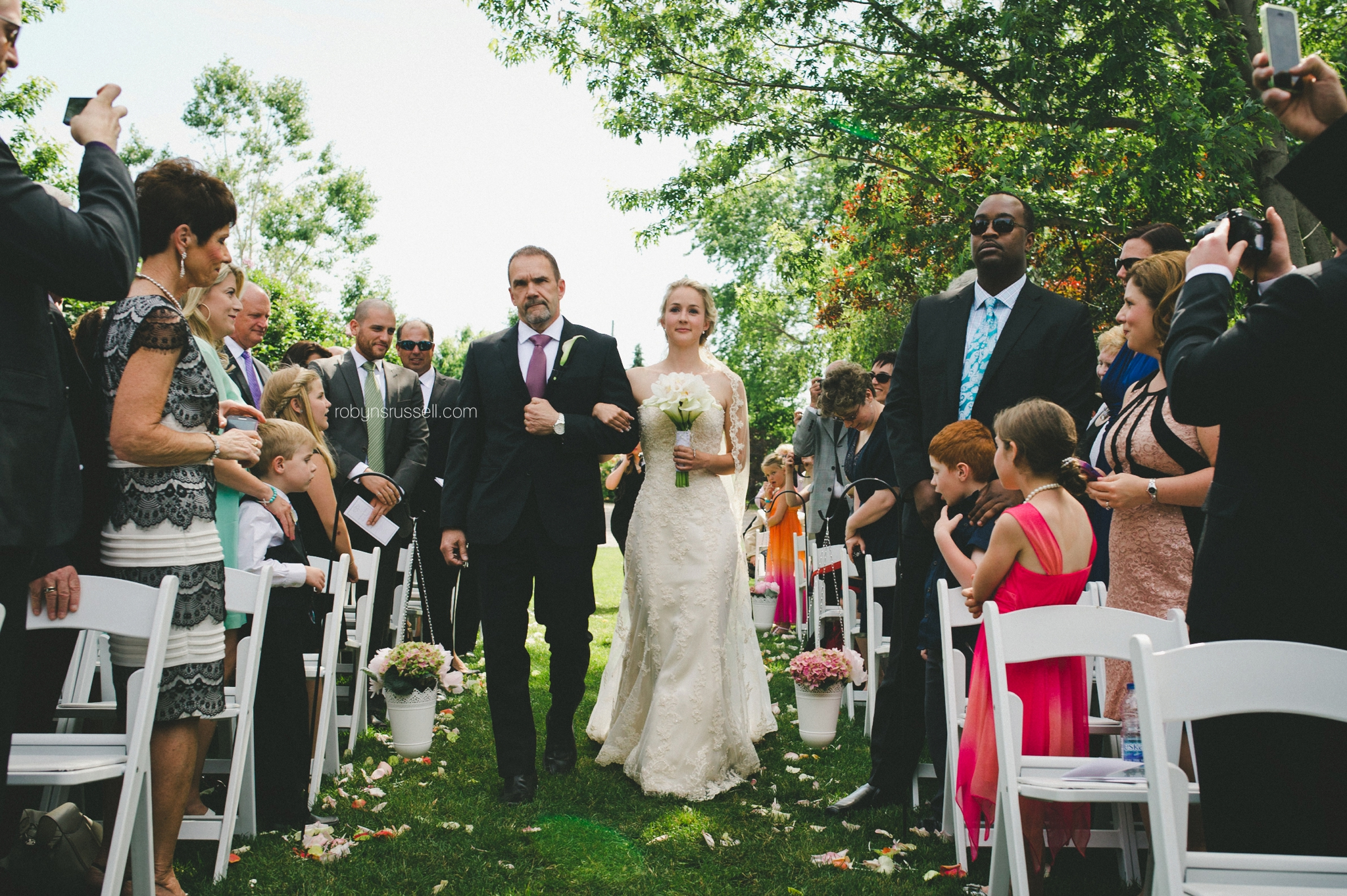 22-bride-walking-down-aisle-with-father-pipers-heath-oakville.jpg