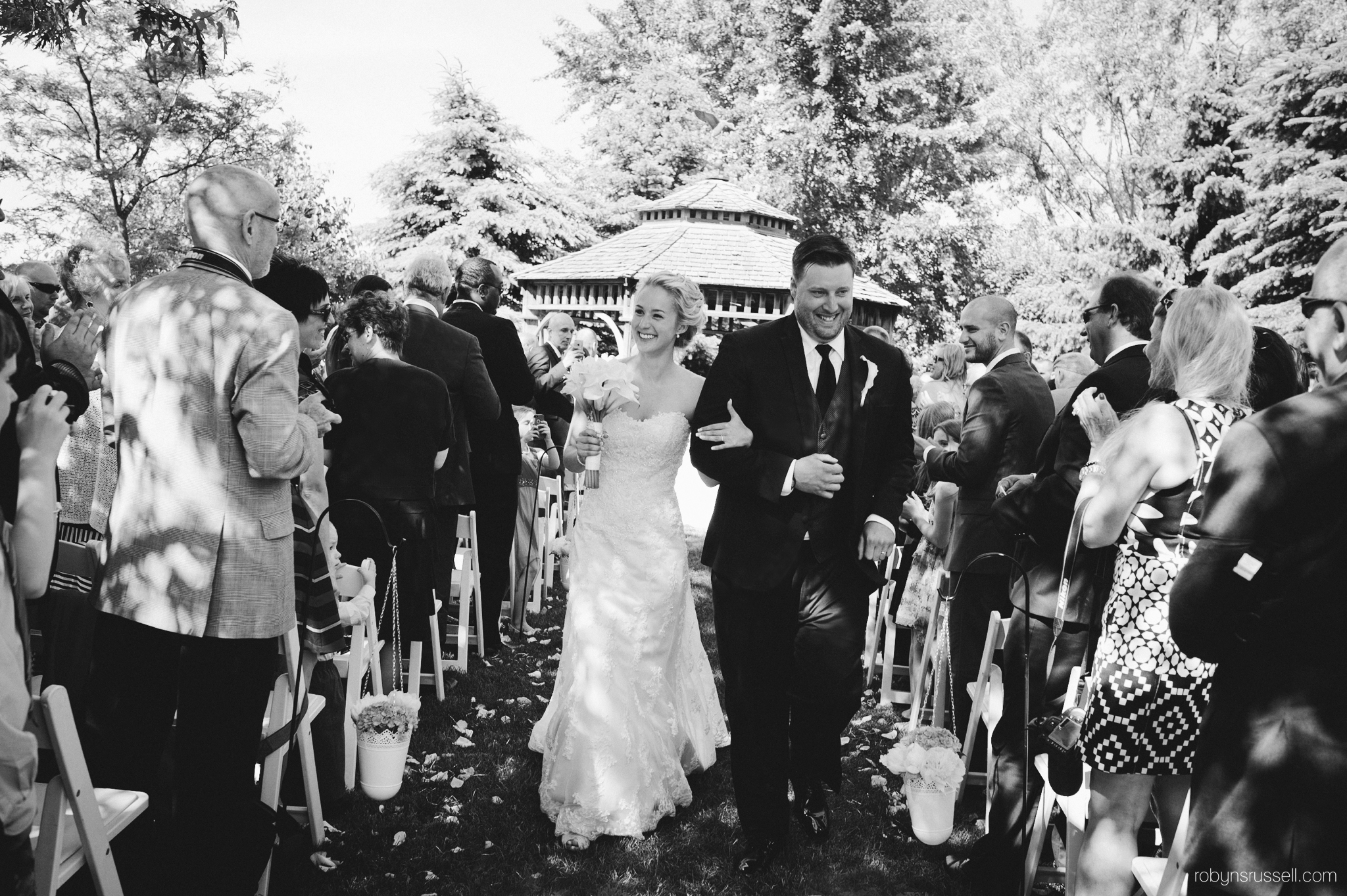 29-bride-and-groom-processional-pipers-heath-bw
