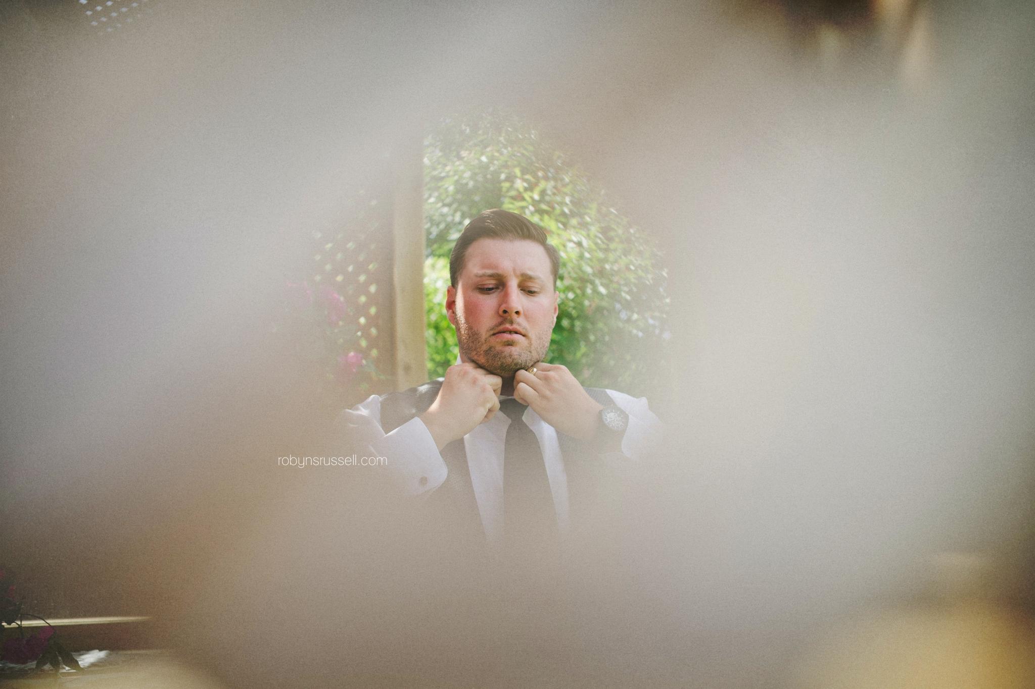 3-groom-putting-on-suit.jpg