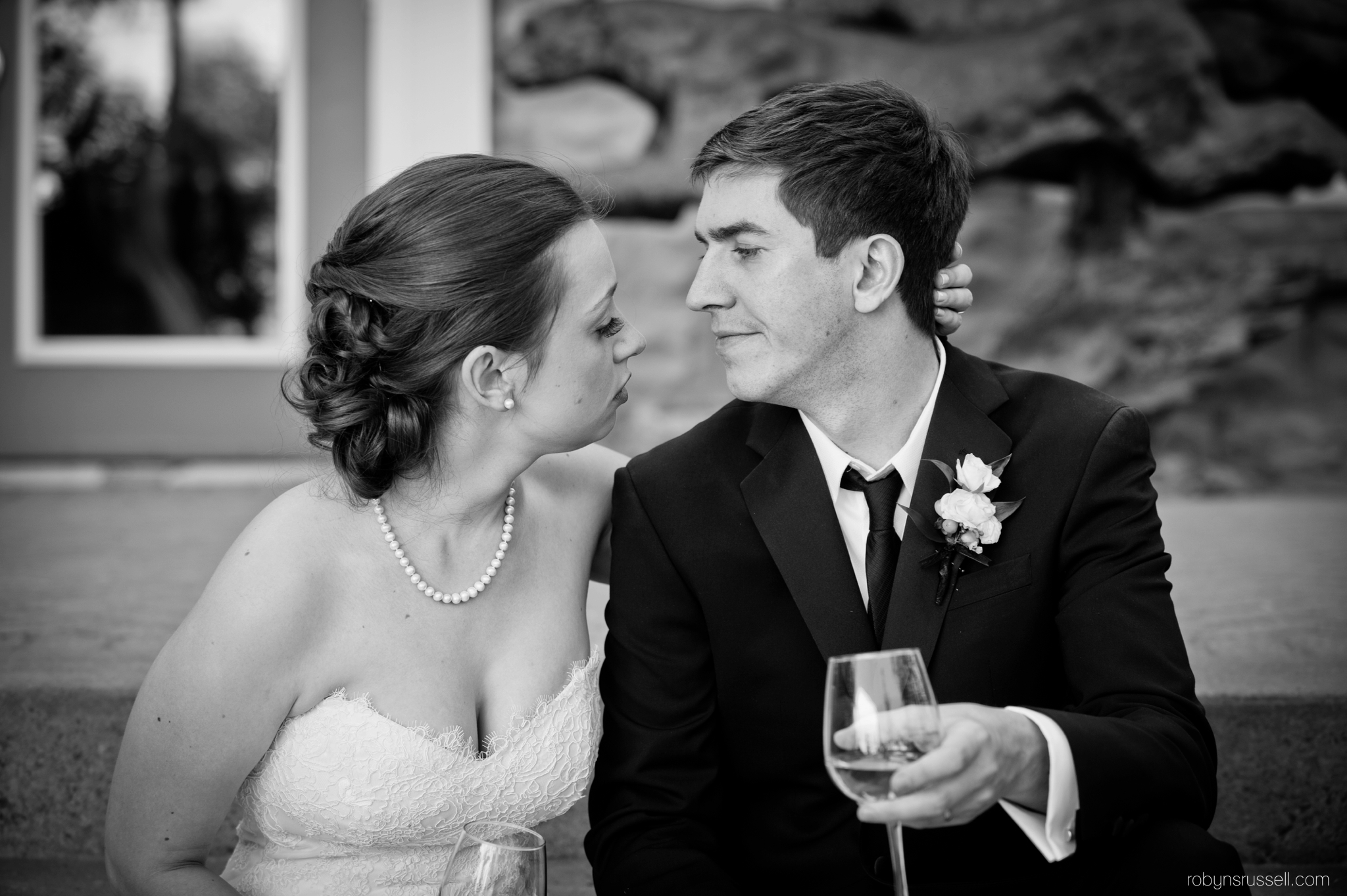 32-bride-and-groom-drinking-champagne.jpg