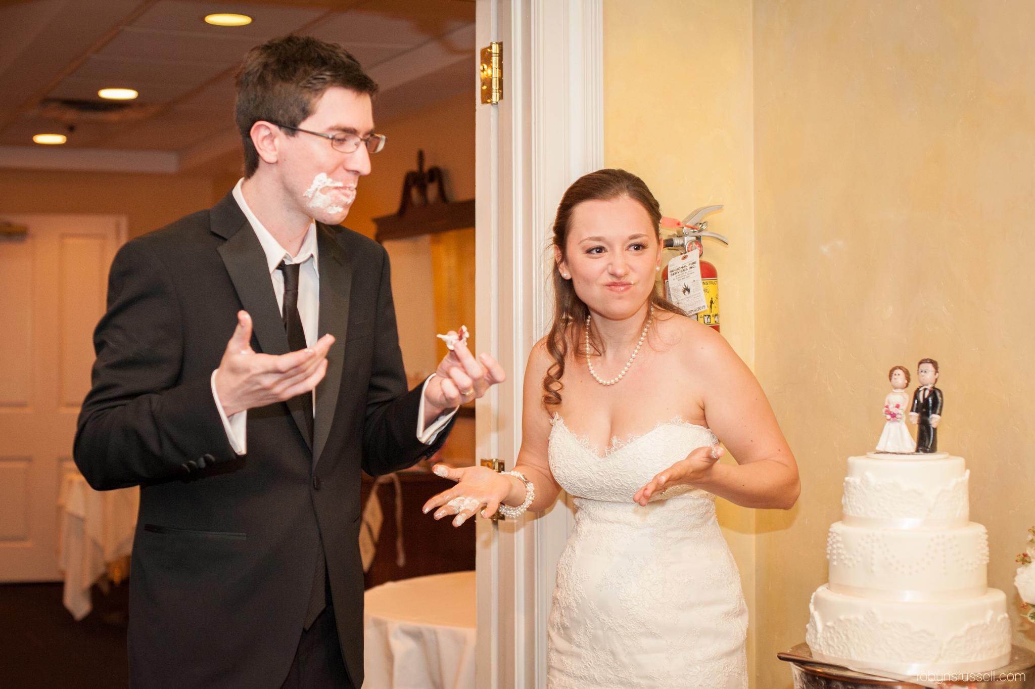 41-bride-and-groom-cut-the-cake-at-inn-on-the-twenty.jpg