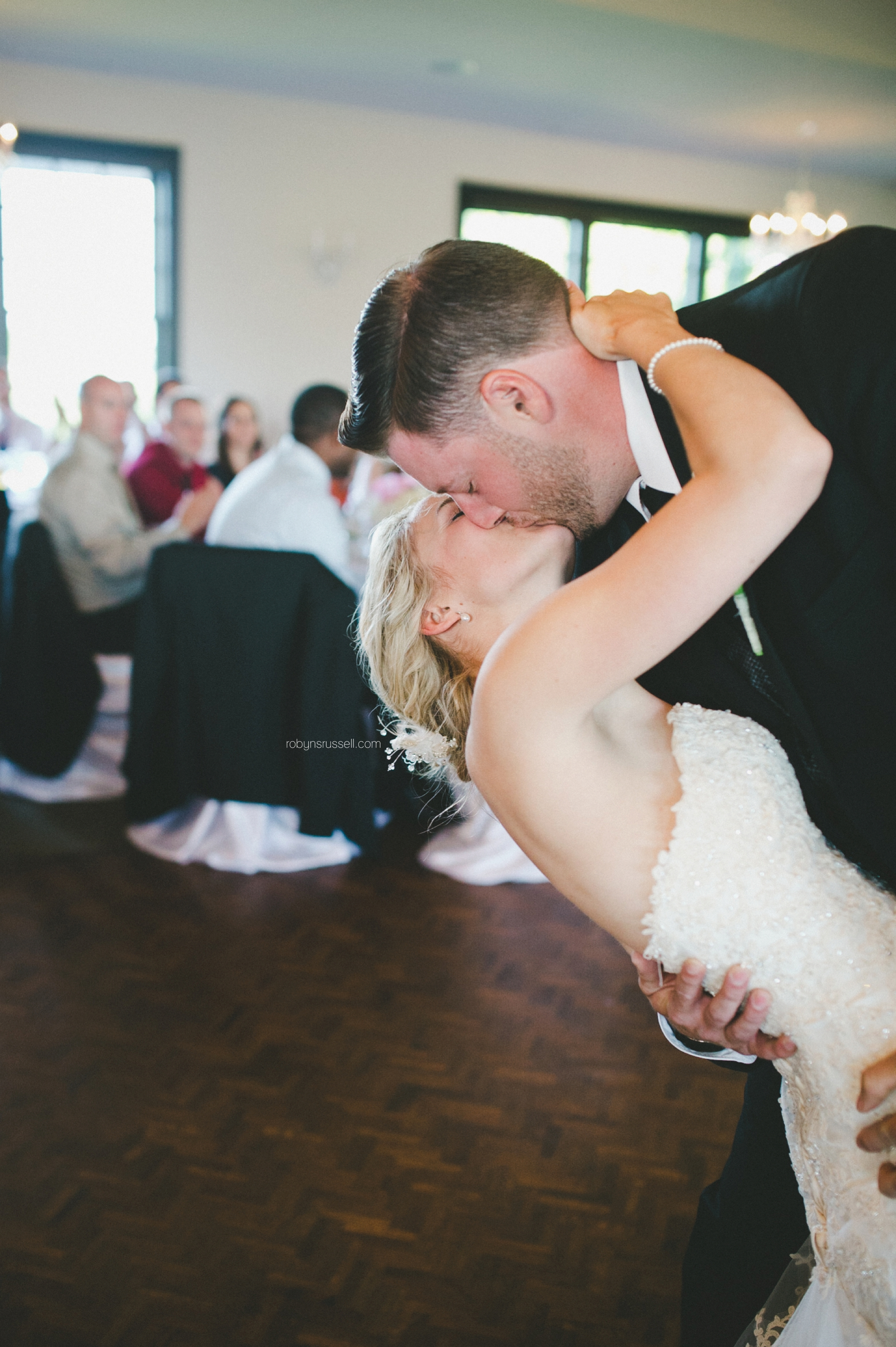 49-bride-and-groom-kiss-during-first-dance.jpg