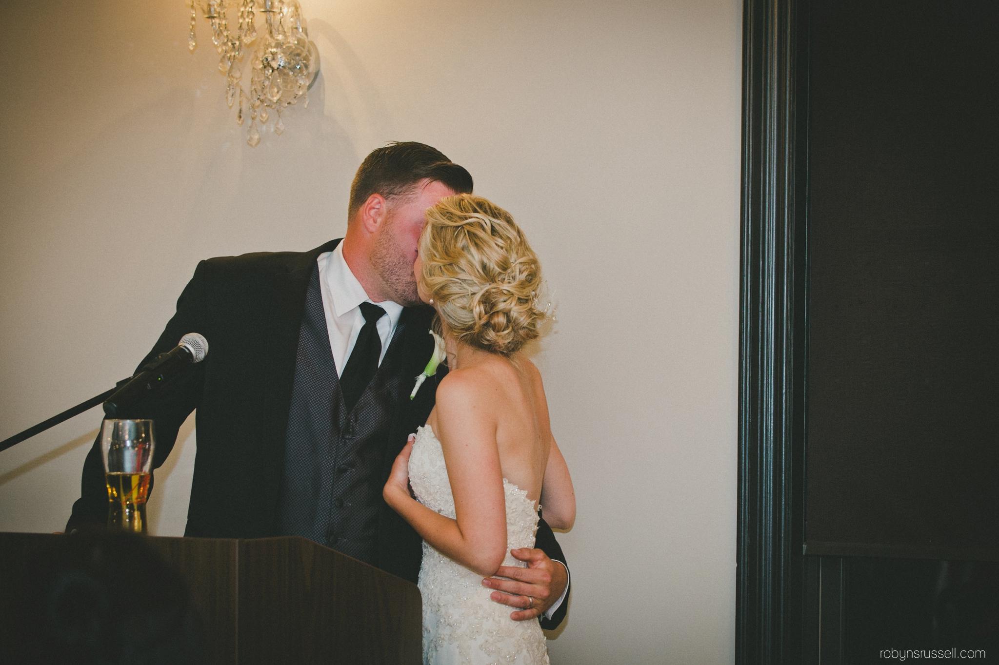 67-bride-and-groom-kiss-after-speech.jpg