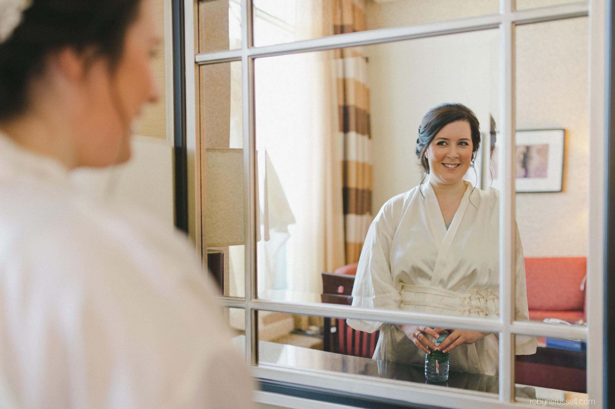 01-bride-looking-in-mirror.jpg