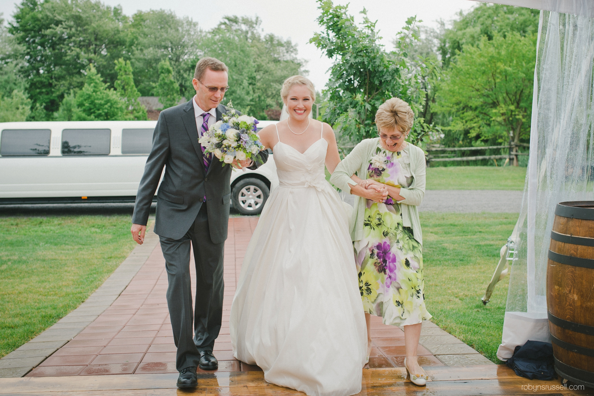 0294-bride-and-parents-walk-aisle.jpg