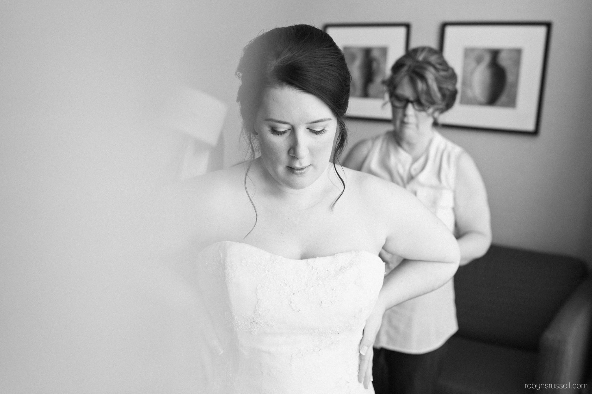 04-bride-getting-dress-on.jpg