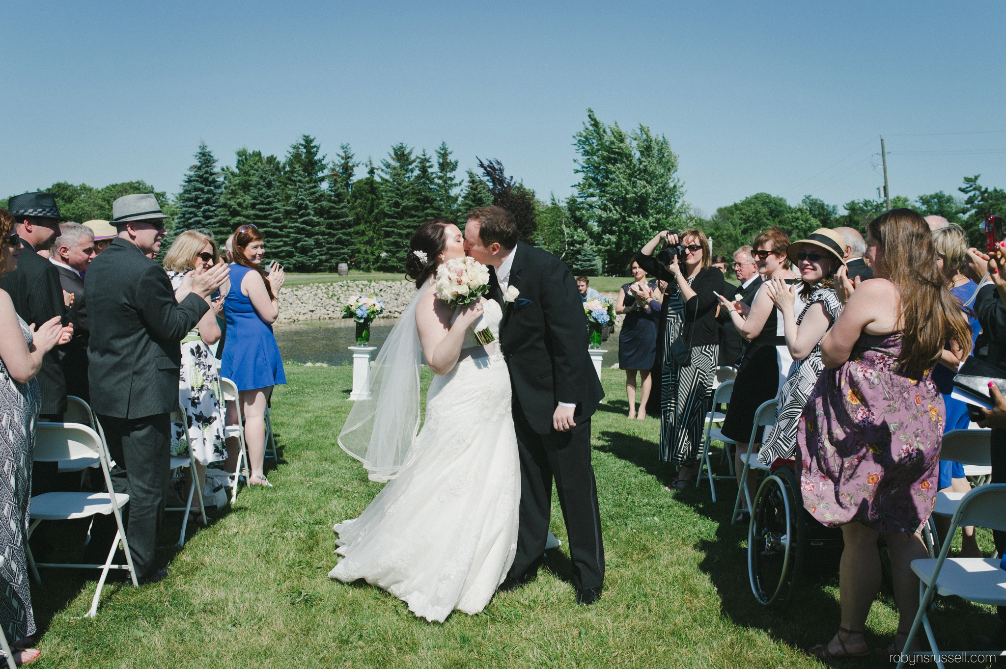 22-bride-and-groom-kiss-recessional.jpg