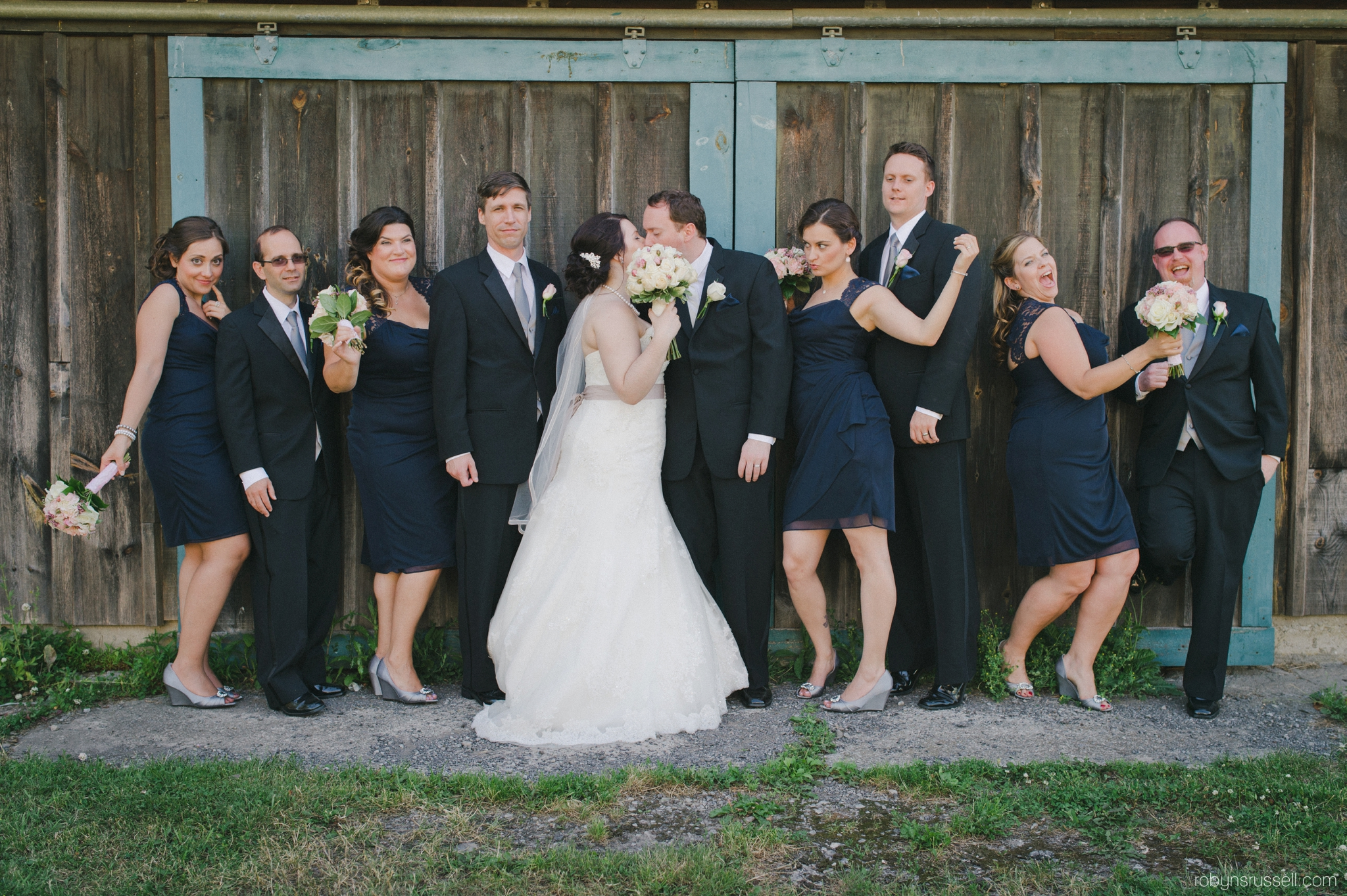 29-bride-and-groom-kissing-bridal-party-hernder.jpg
