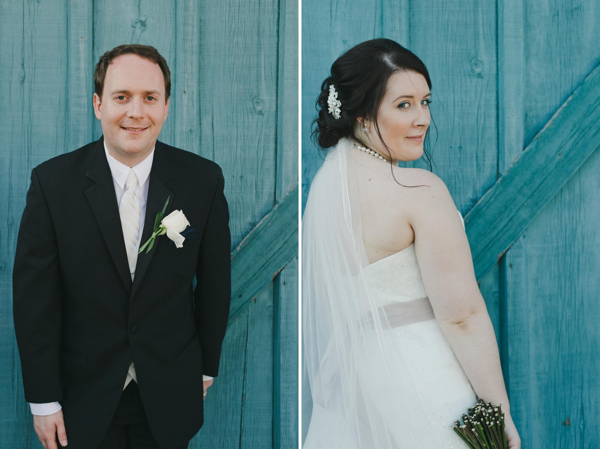 33-bride-and-groom-by-blue-wood-door-hernder.jpg