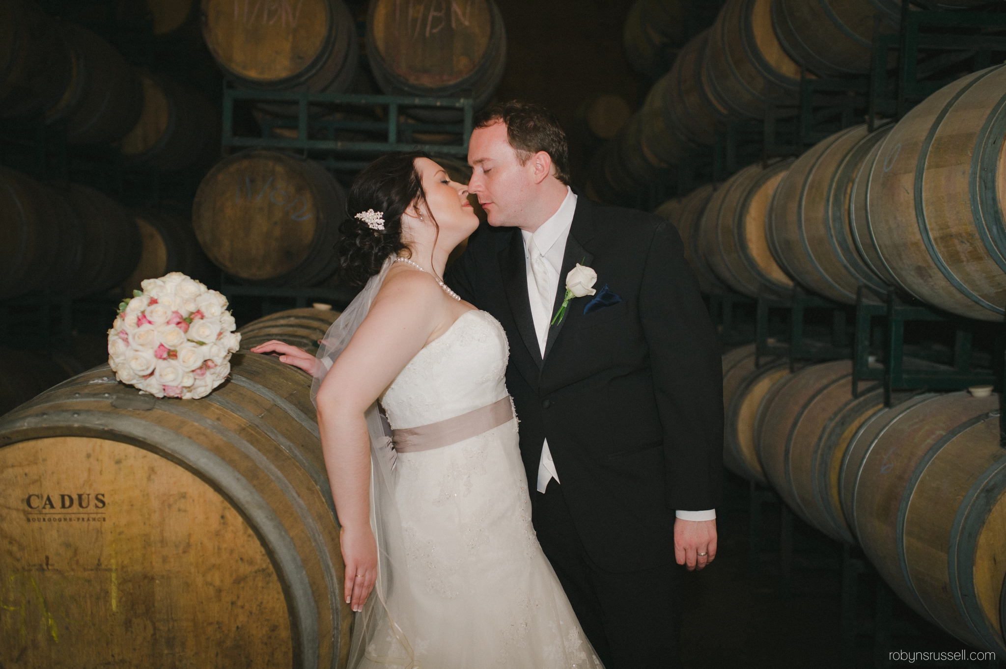 35-married-couple-in-wine-cellar-hernder-winery.jpg
