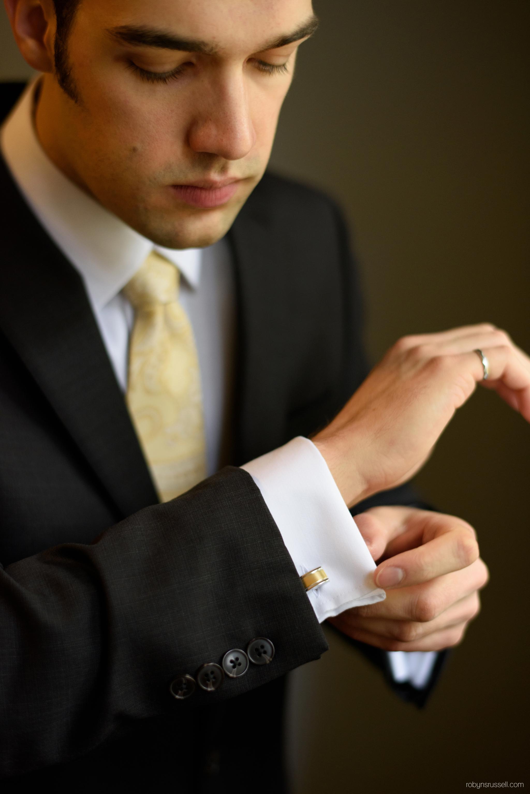 2-groom-wearing-cufflinks-wedding-day.jpg