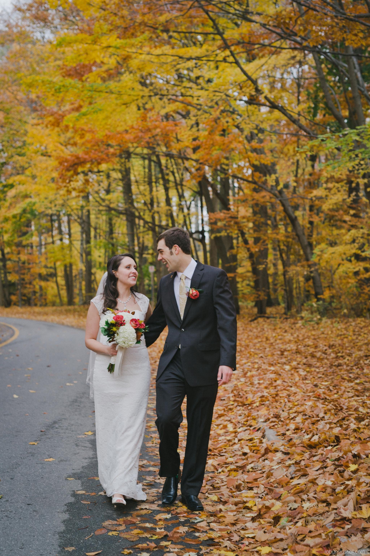 44-bride-and-groom-walking-fall-leaves-wedding.jpg