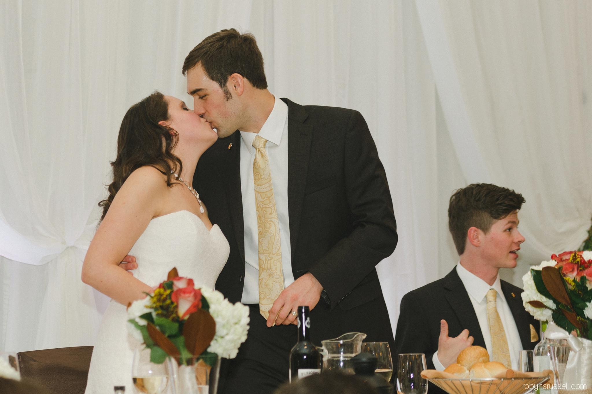 58-kissing-couple-on-wedding-day.jpg