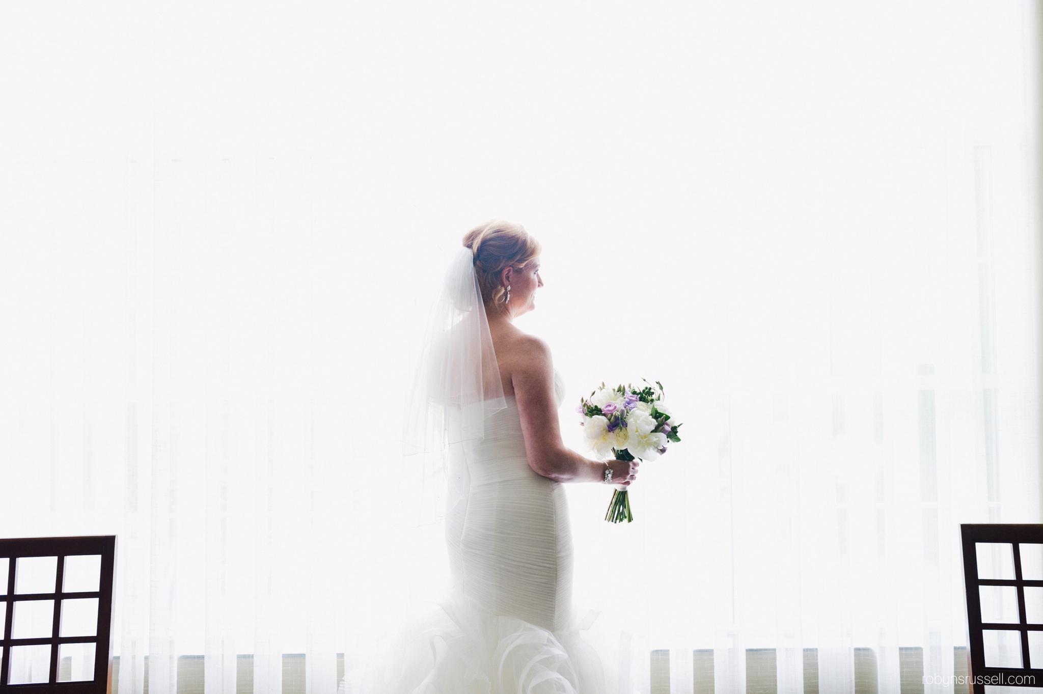 11-bride-by-window-dramatic-portrait-oakville-hotel-staybridge-suites.jpg