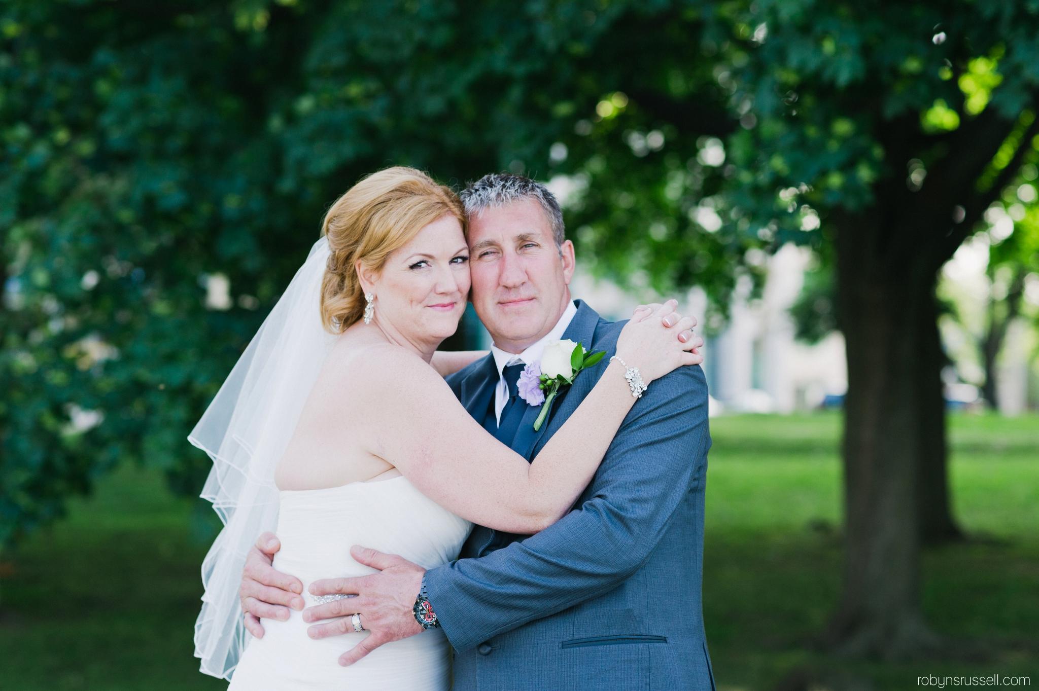 23-bride-and-groom-on-wedding-day-oakville-marina.jpg