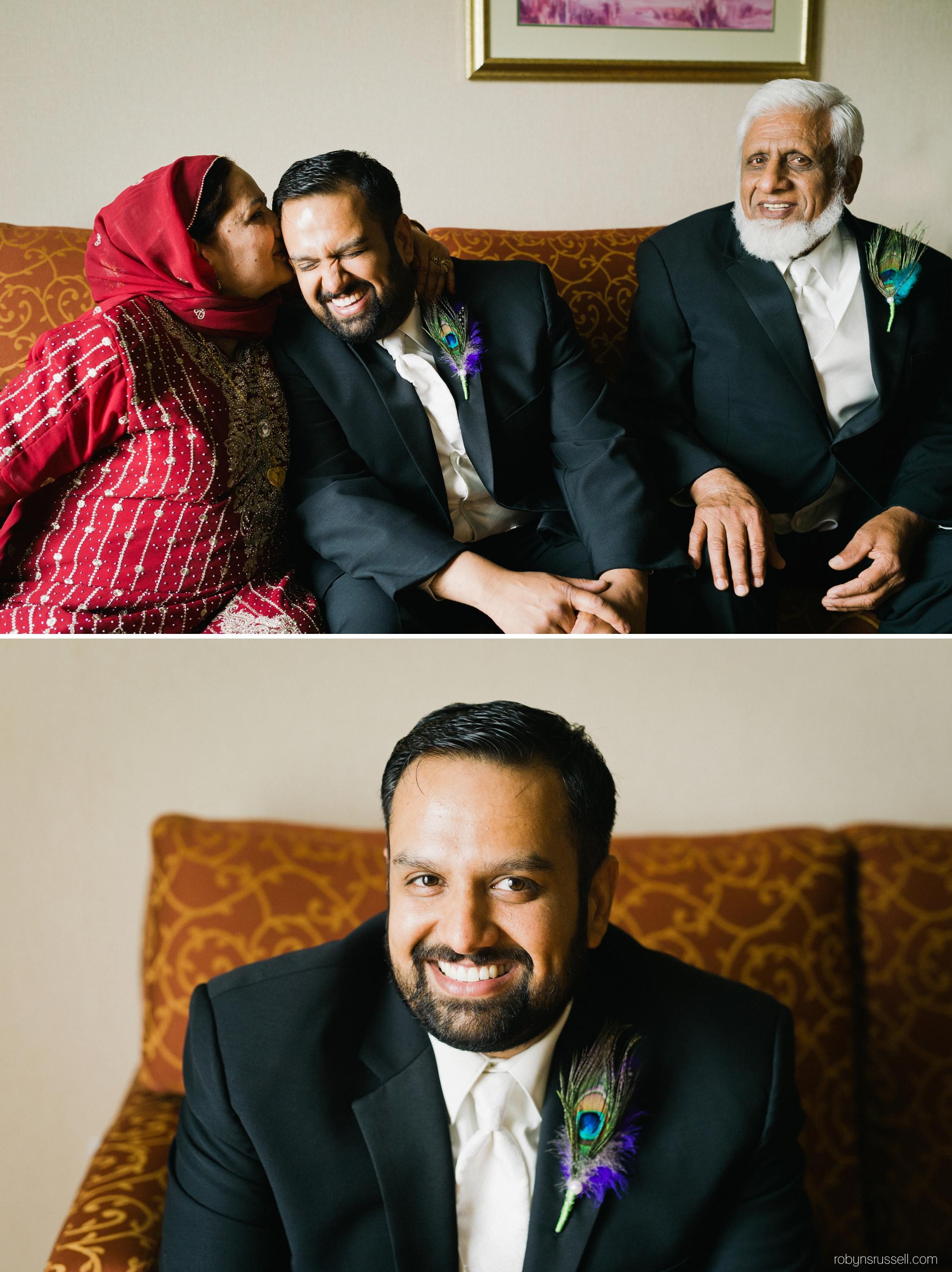 3-groom-with-parents-cambridge-wedding-photographer.jpg