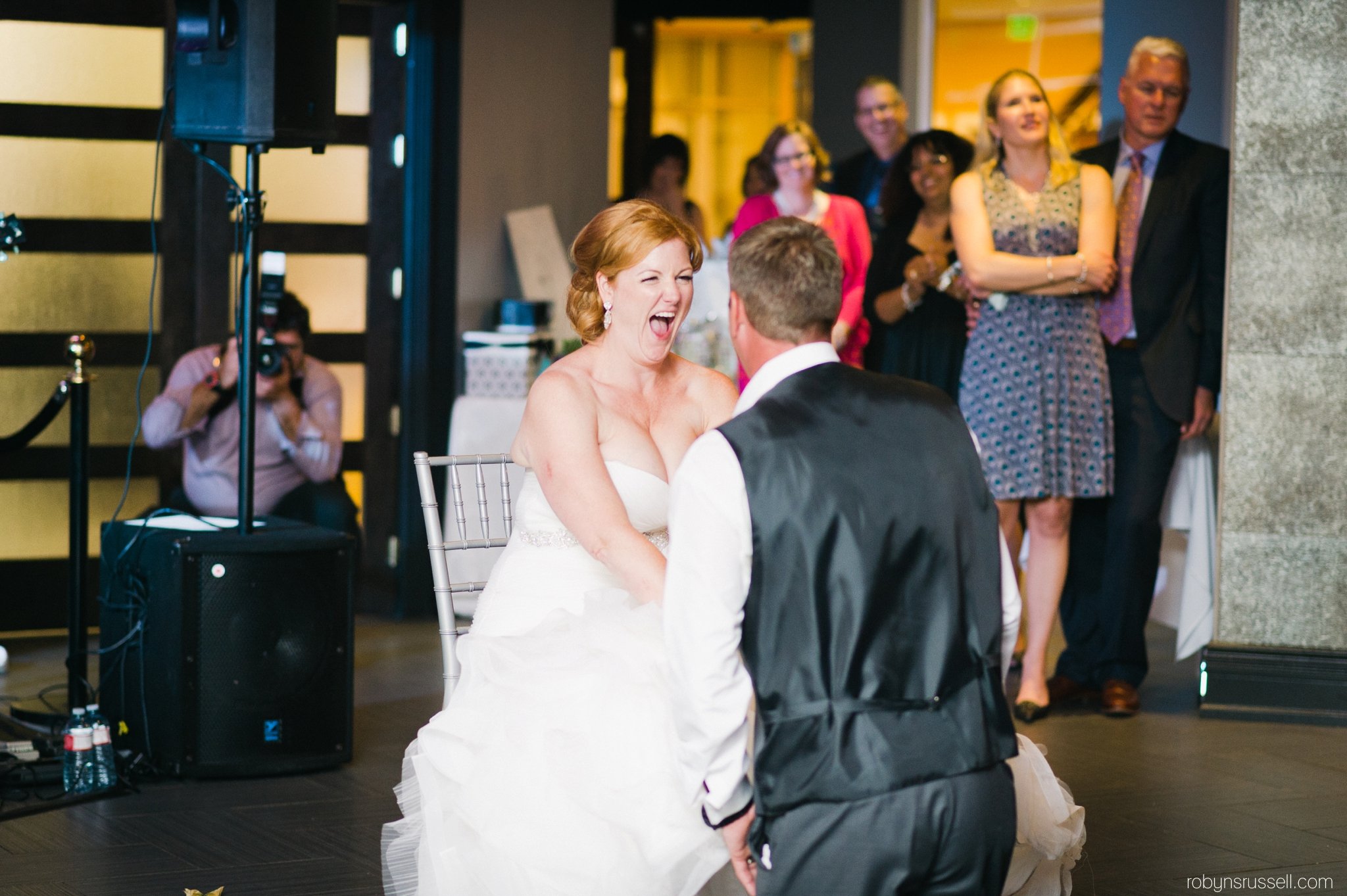 40-bride-and-groom-garter-toss-oakville-wedding-photographer.jpg
