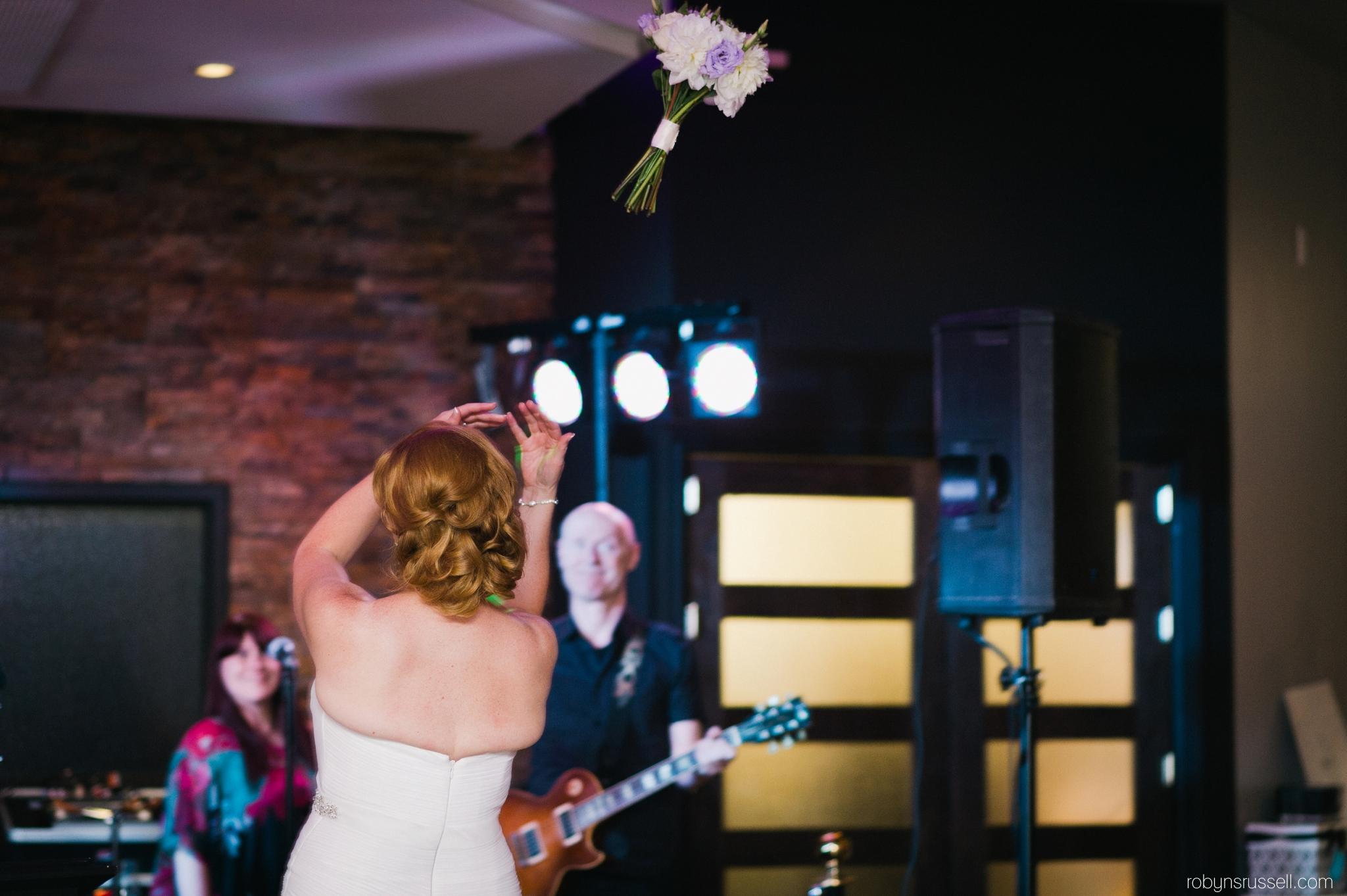 41-bride-tosses-bouquet-harbour-banquet-hall.jpg