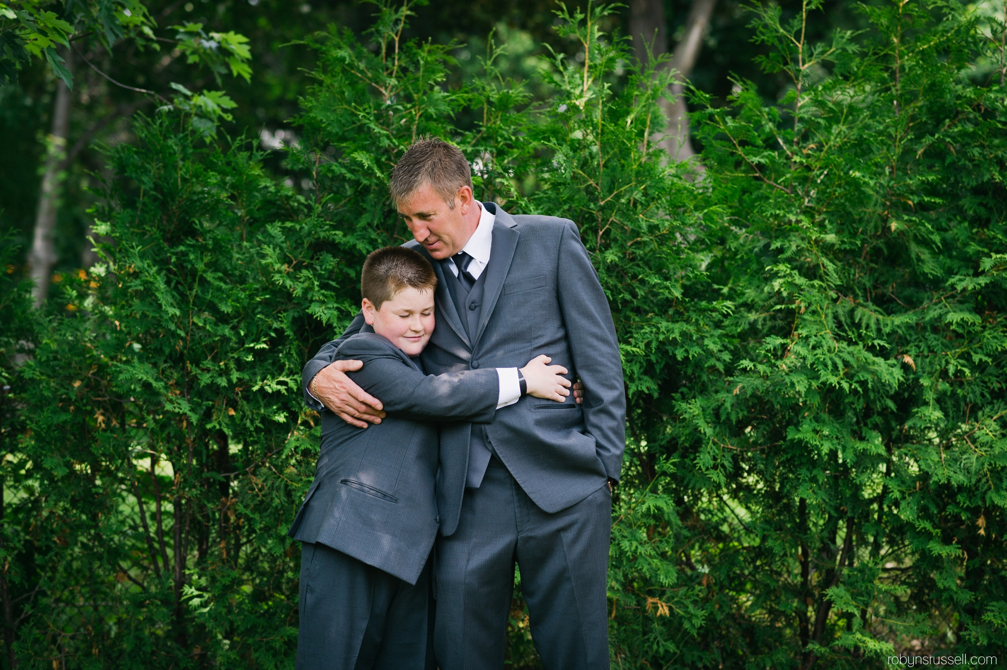 5-groom-and-son-emotional-moment-before-ceremony.jpg