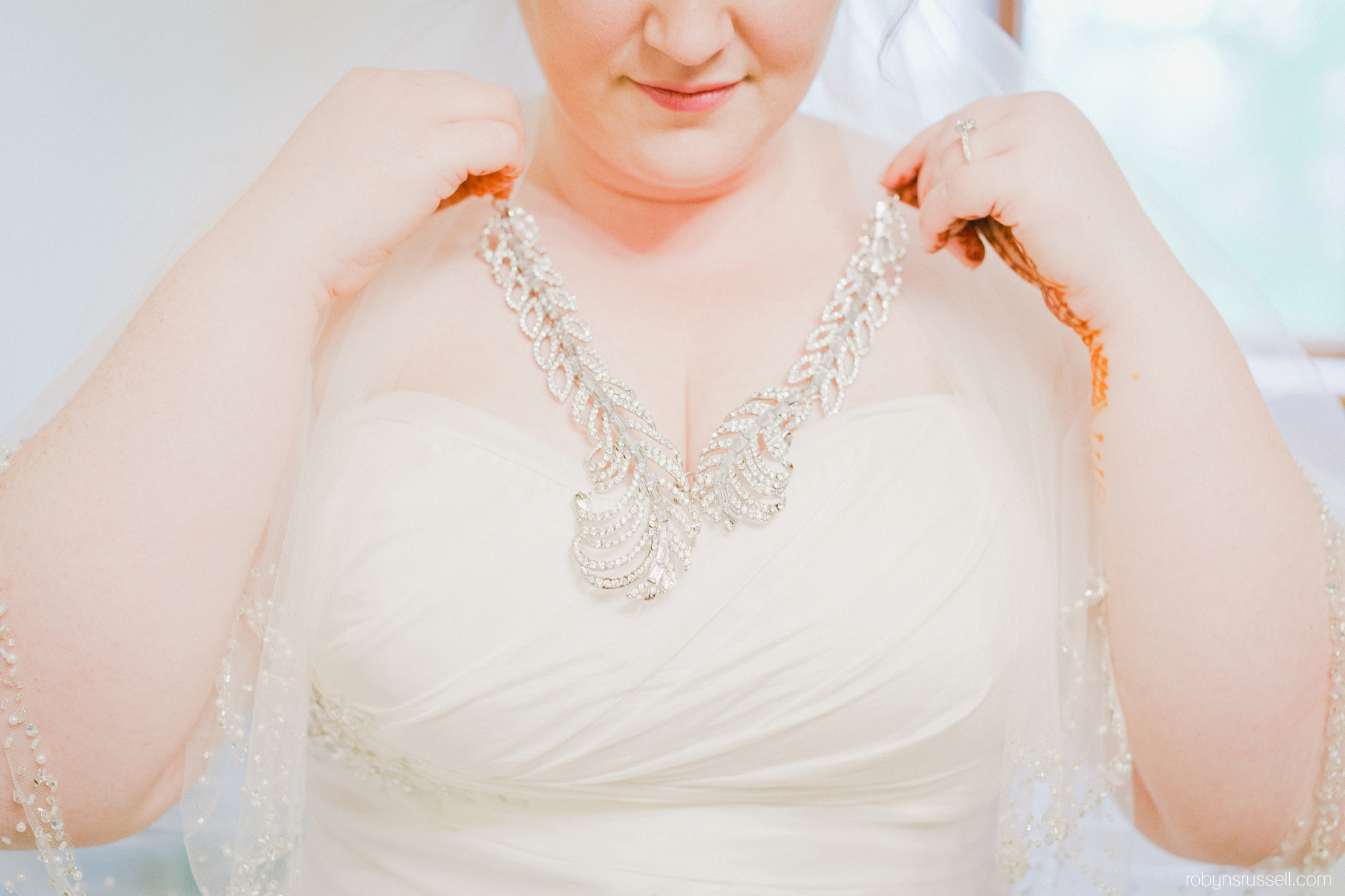 7-bride-wearing-beautiful-necklace-on-wedding-day.jpg