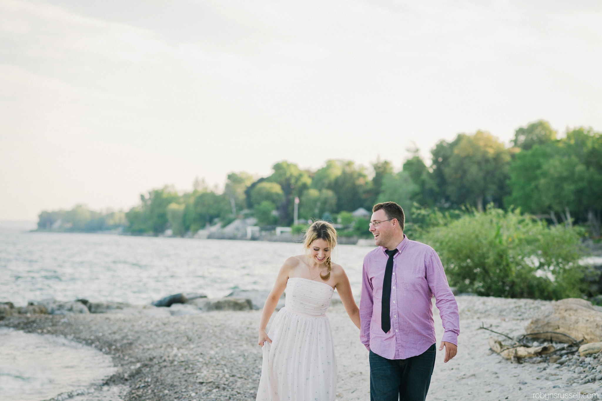 8-walking-along-the-water-burlington-paletta-engagement.jpg