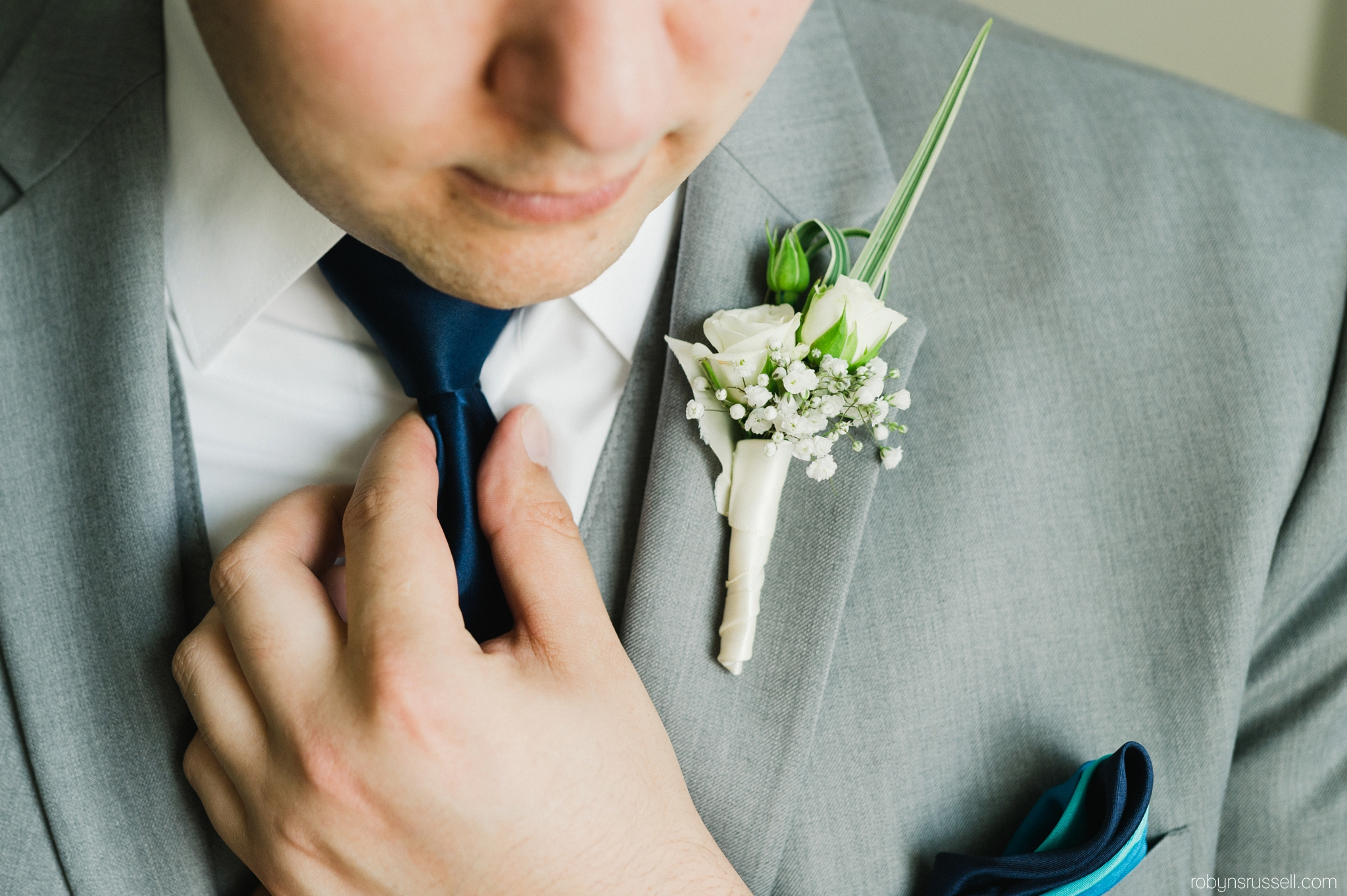 1-groom-fixing-tie.jpg