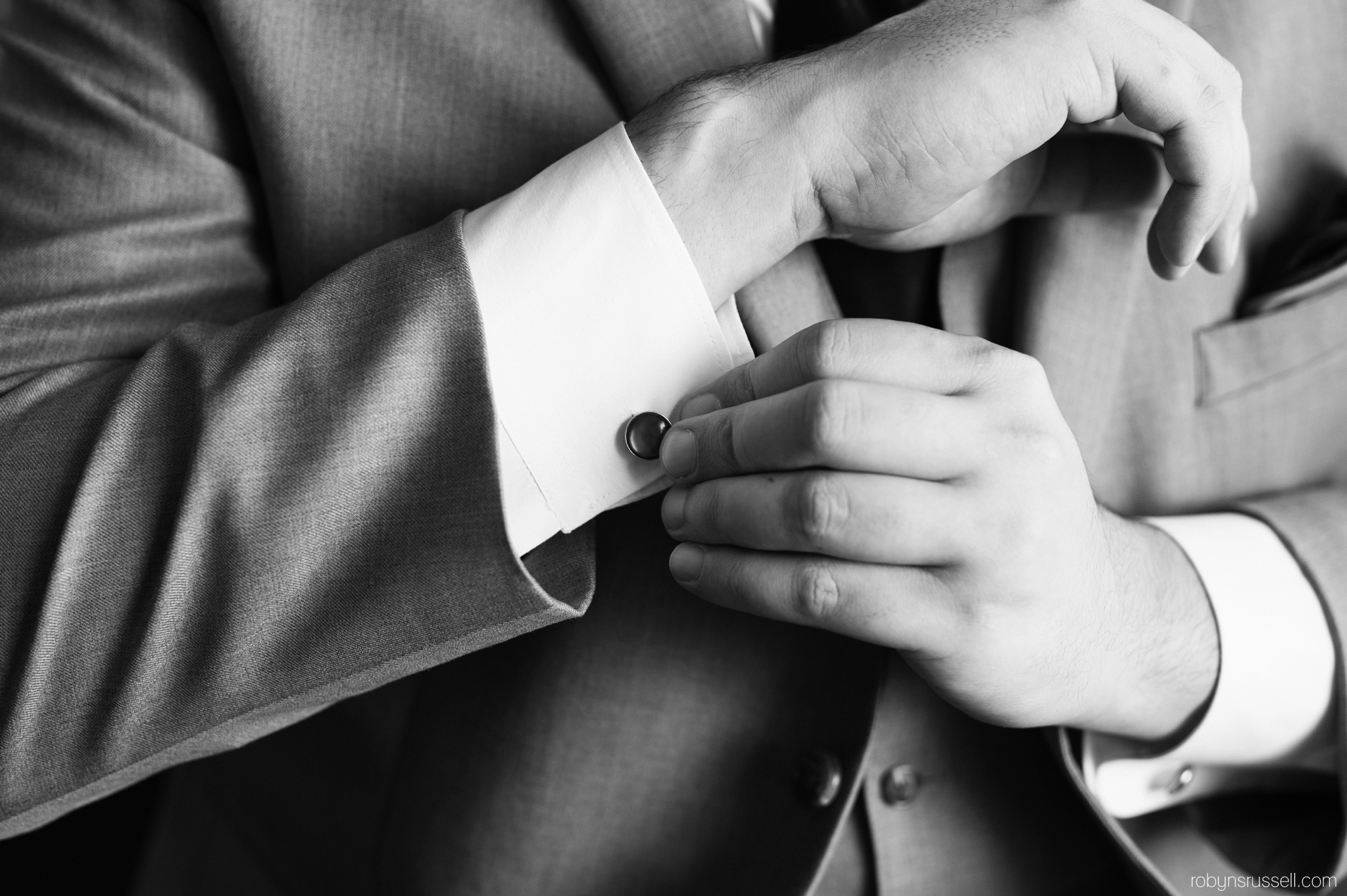 2-groom-adjusting-cufflinks-barrie-wedding-photographer.jpg