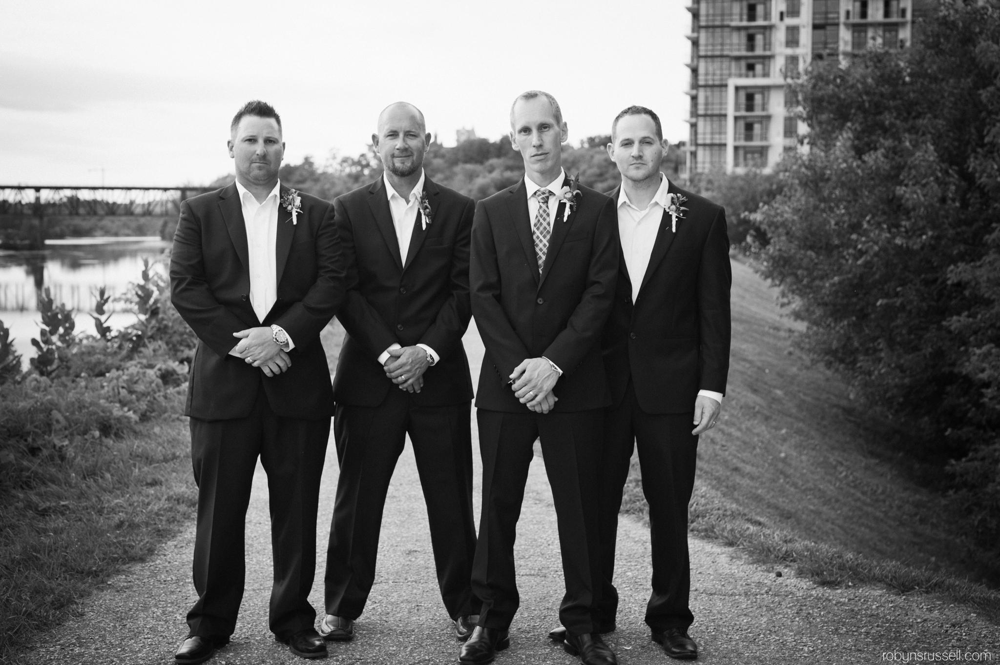 36-handsome-groom-and-groomsmen-cambridge-mill-wedding.jpg
