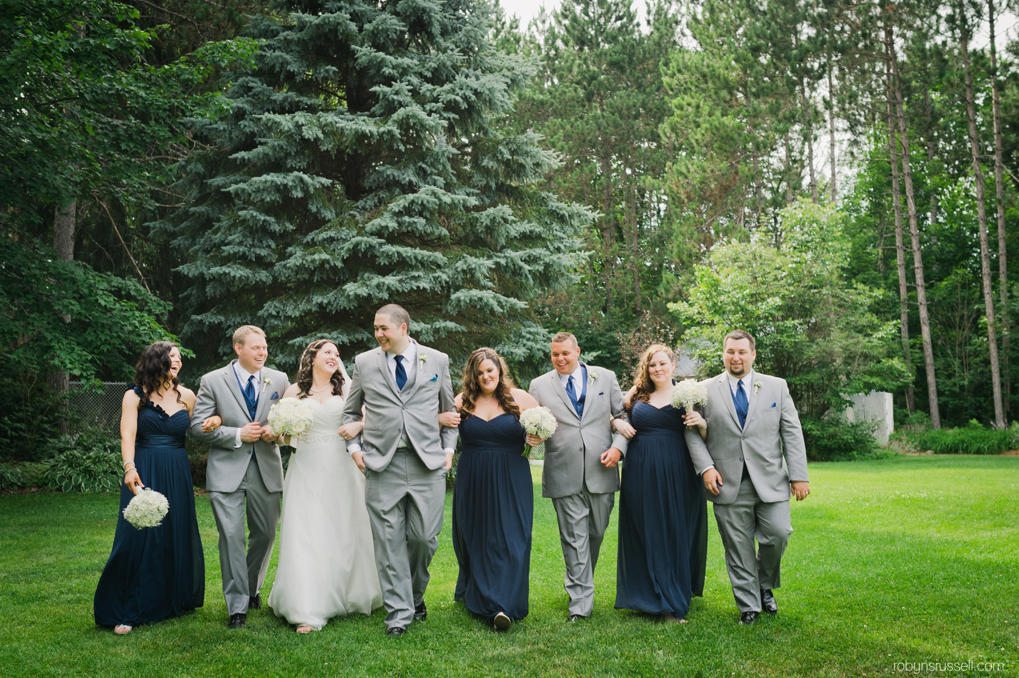 36-walking-shot-bridal-party-laughing.jpg