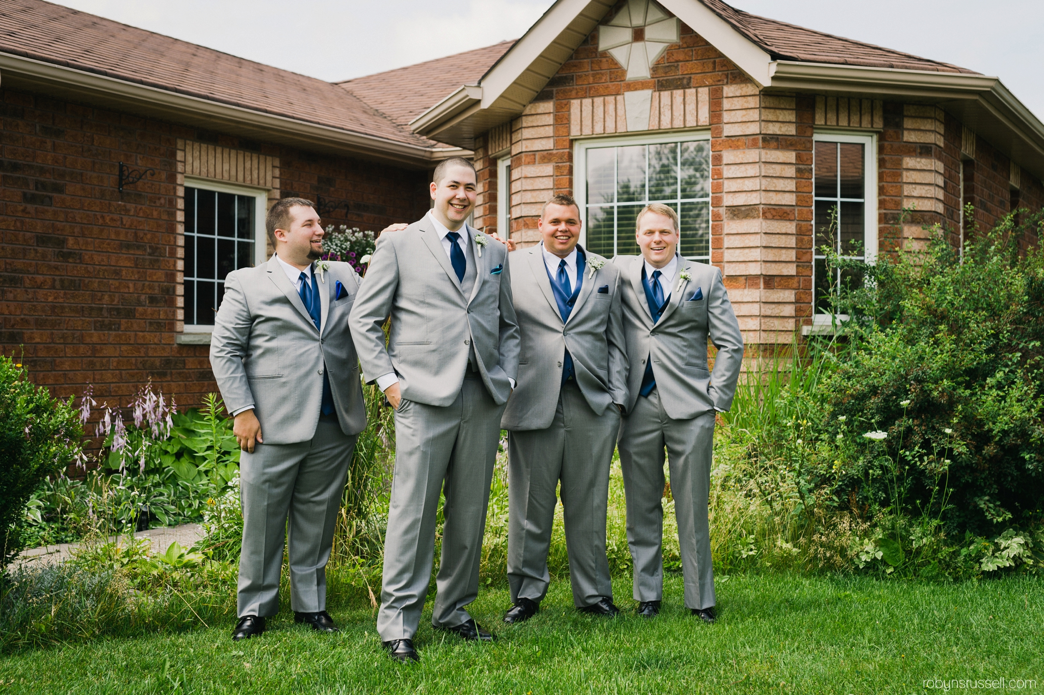 4-groom-and-groomsmen-outside-home-barrie.jpg