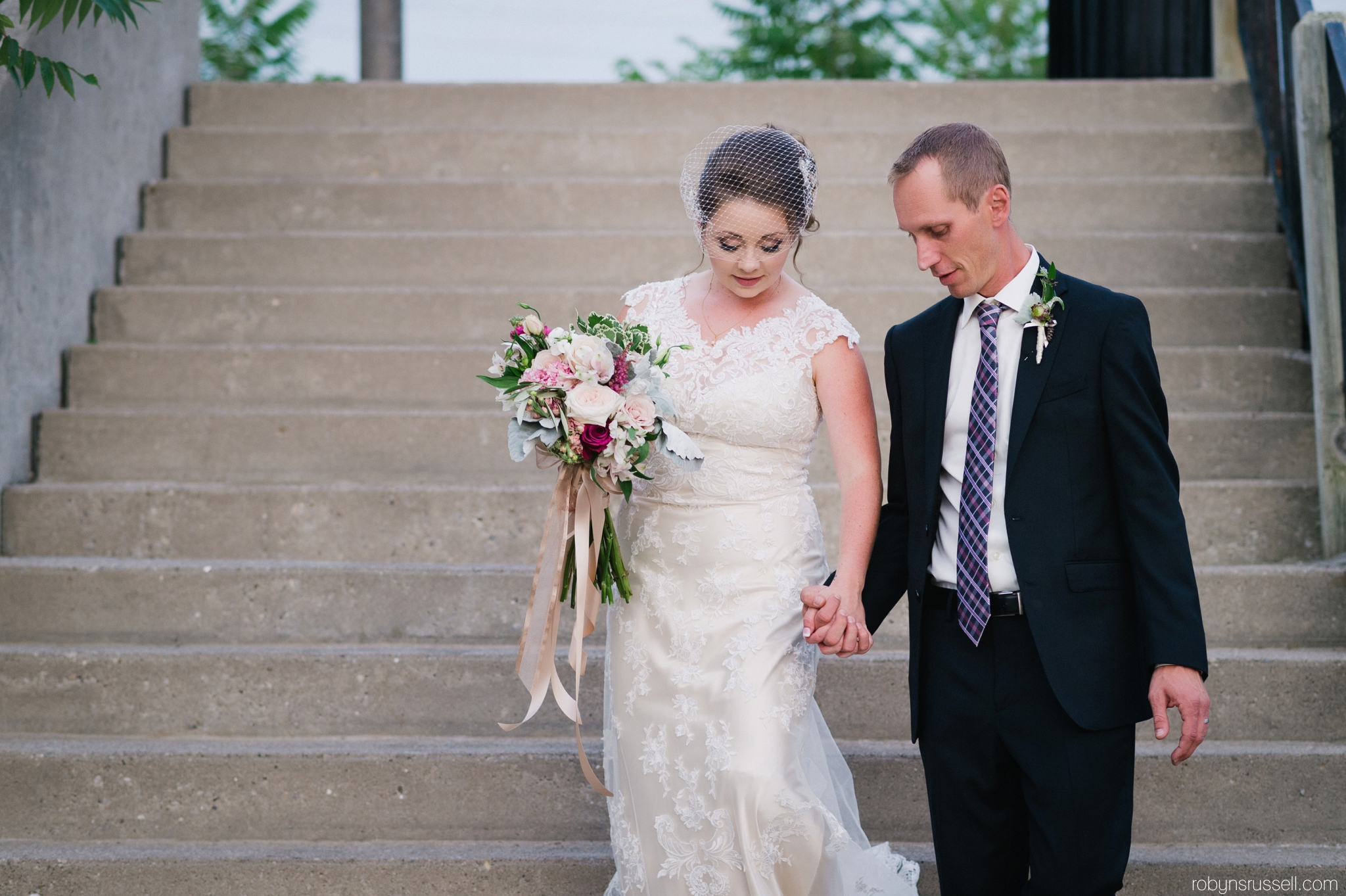 47-bride-and-groom-walking-at-cambridge-mill.jpg