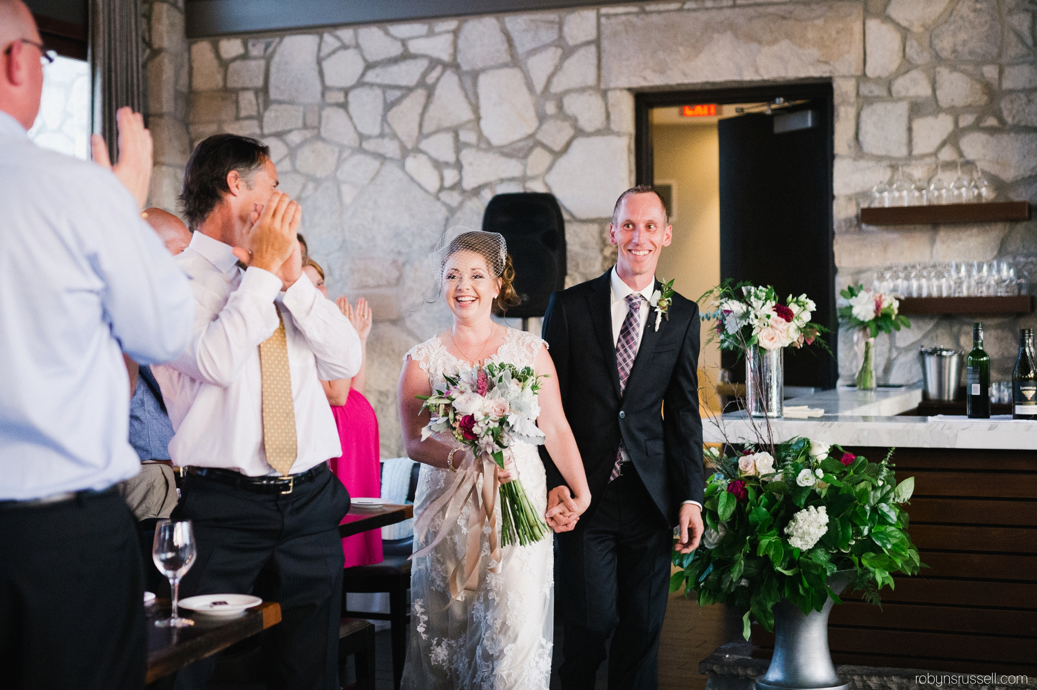 52-bride-and-groom-enter-for-reception.jpg
