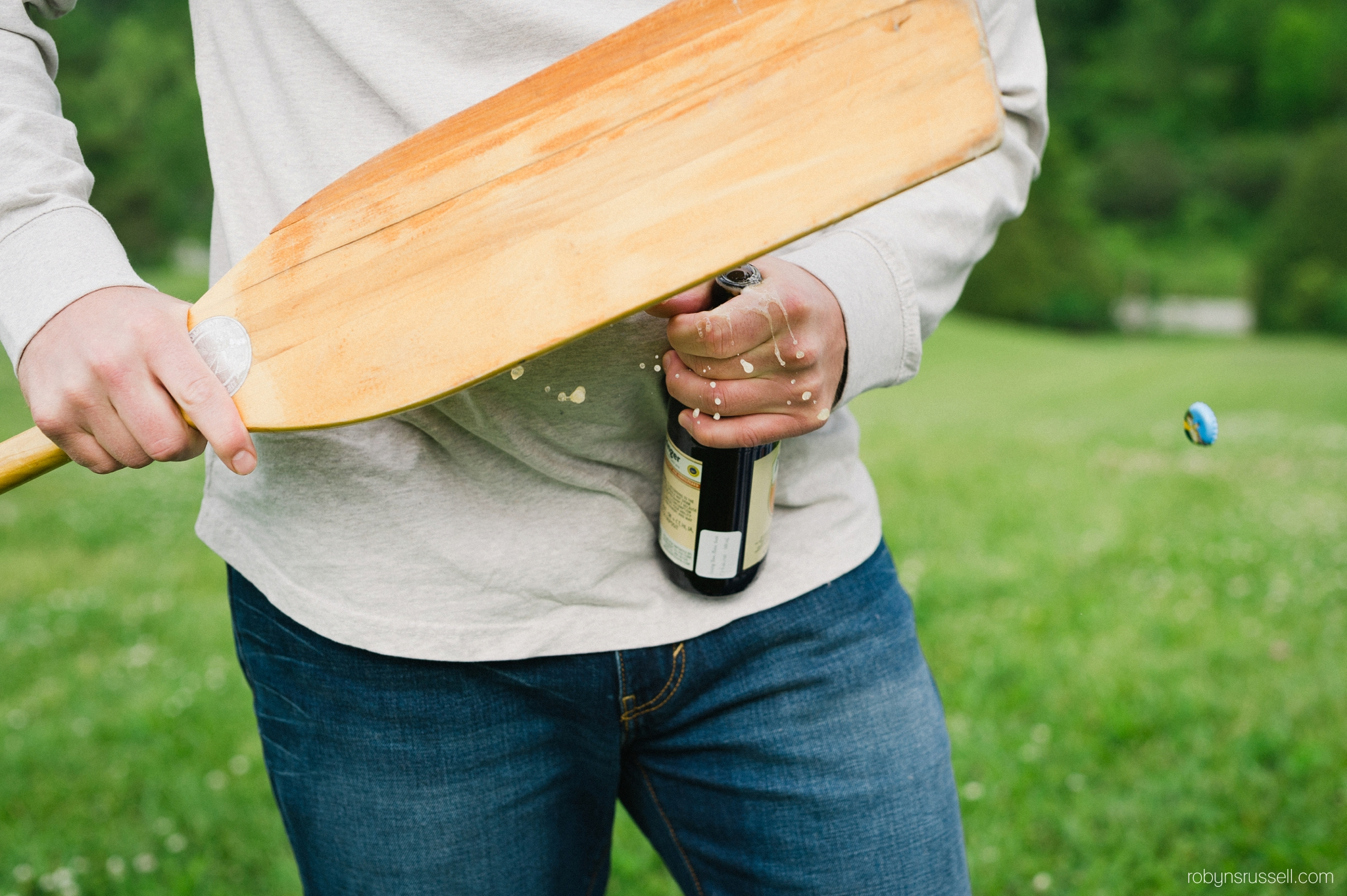 1-cracking-open-beer-with-a-paddle.jpg