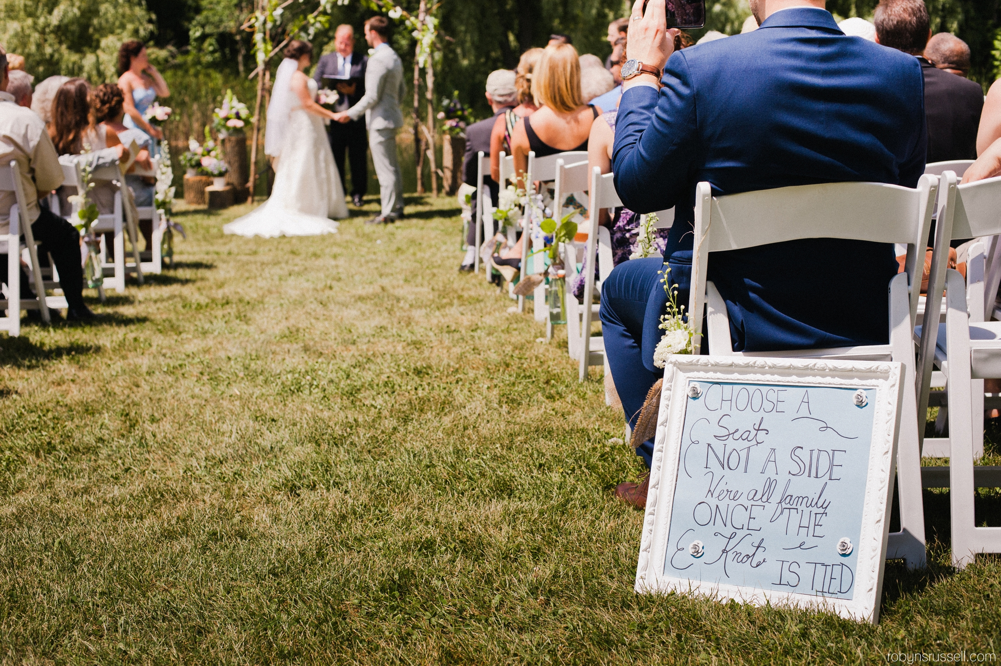 20-wedding-signage-at-ceremony-in-belwood-lake.jpg