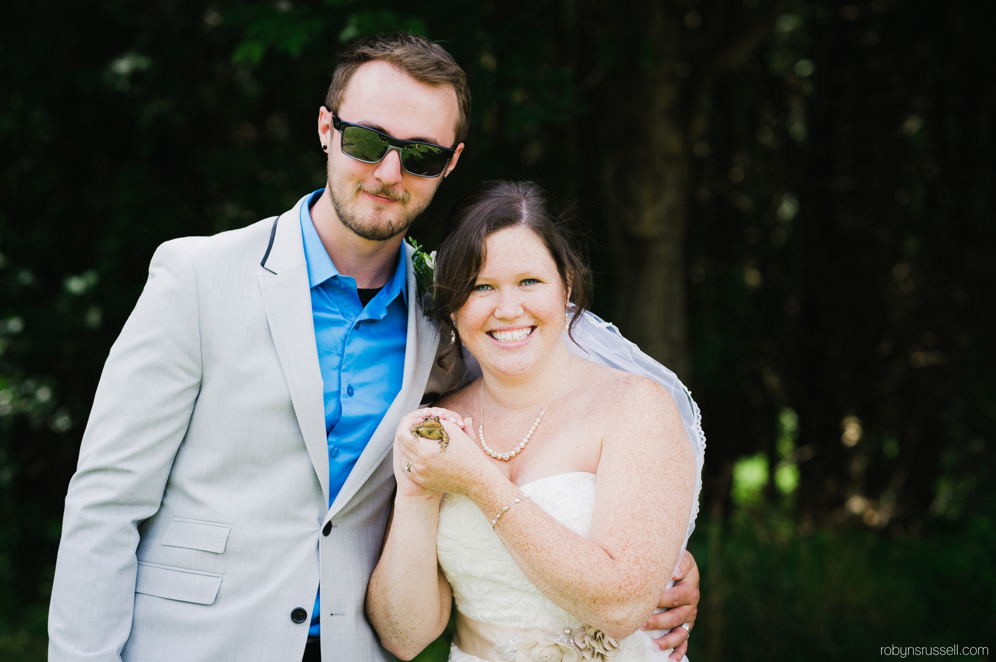 28-bride-and-groom-with-frog.jpg