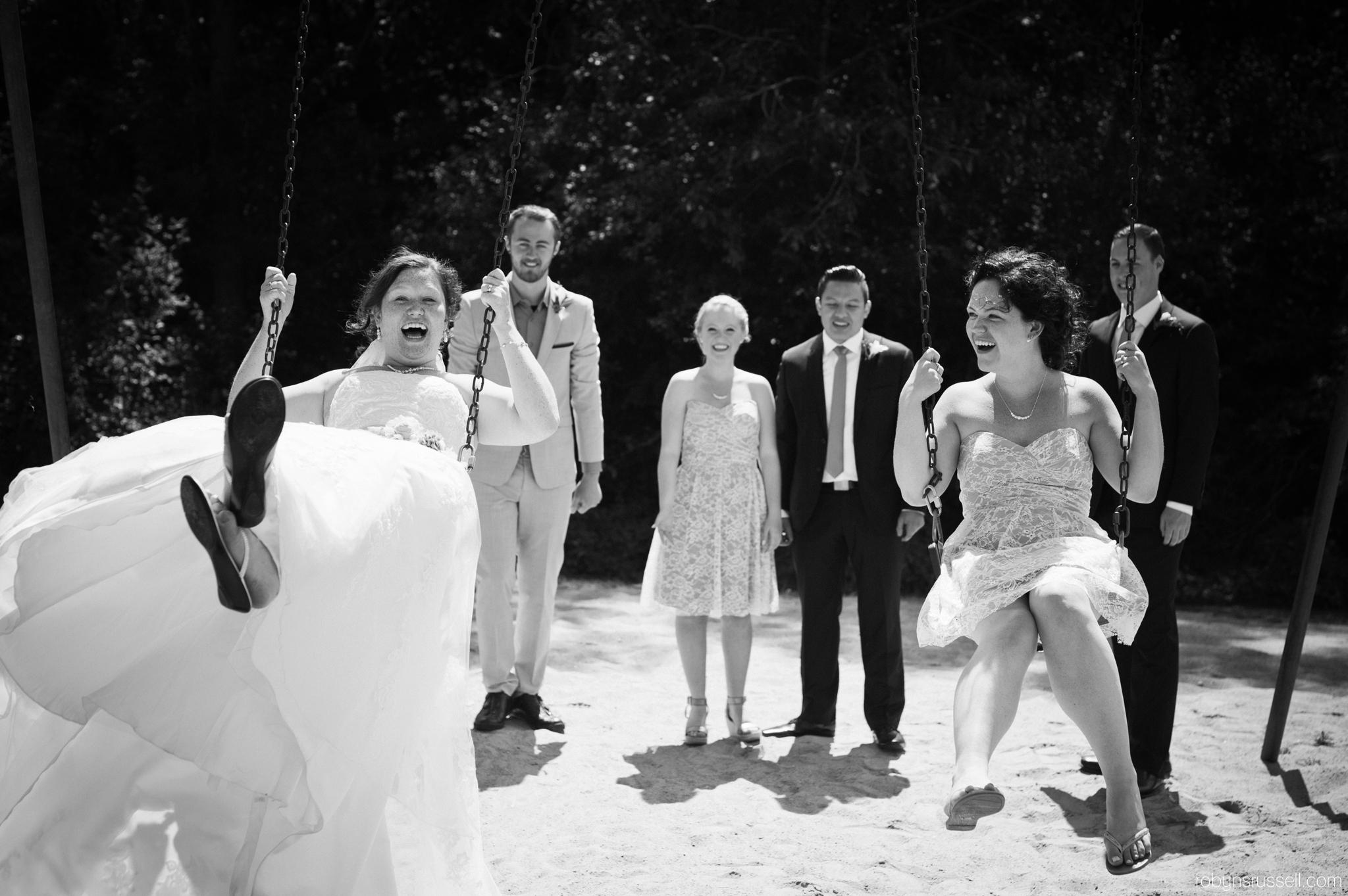 31-bride-and-sister-on-swings.jpg