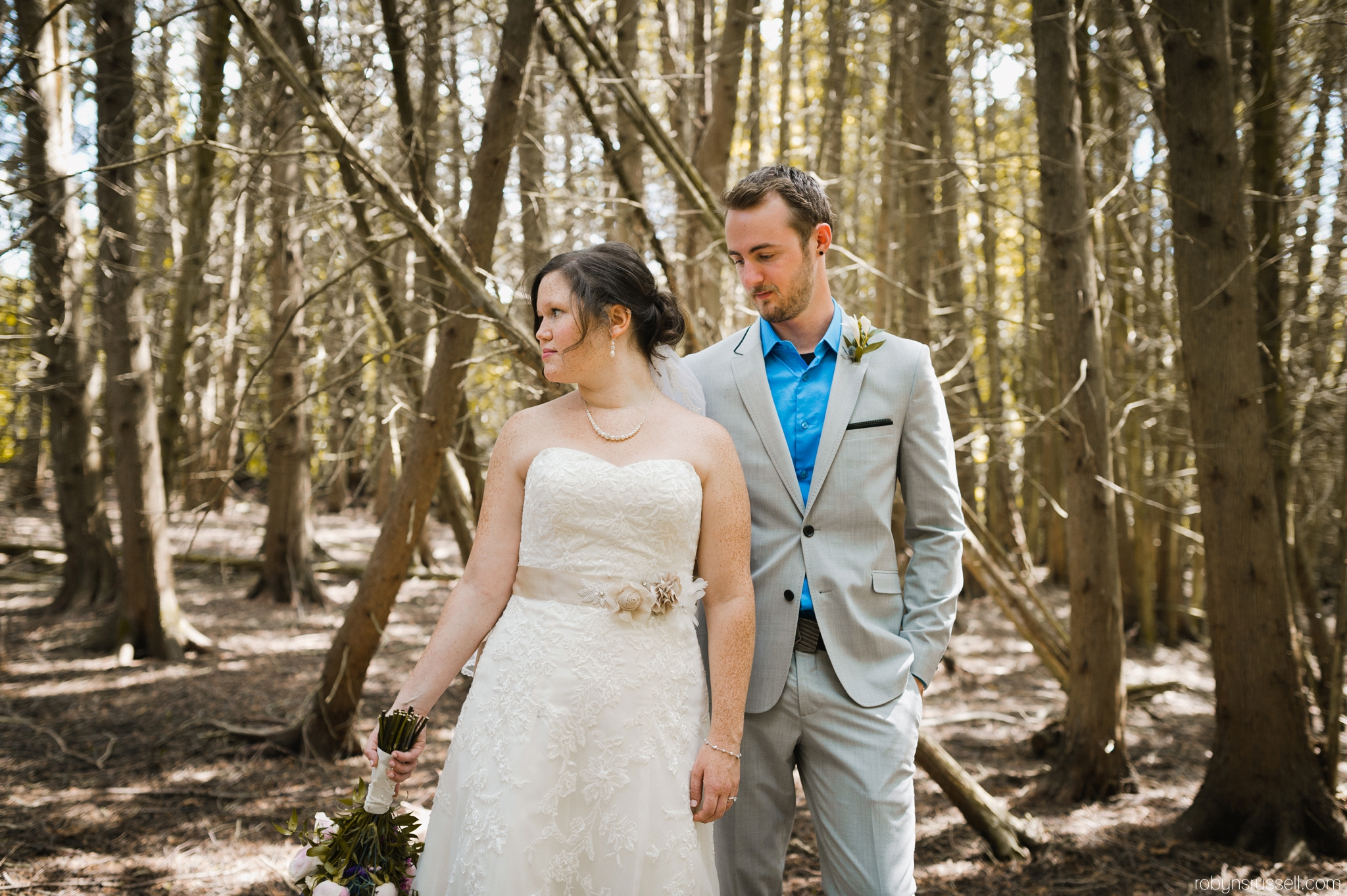 33-bride-and-groom-in-belwood-forest.jpg