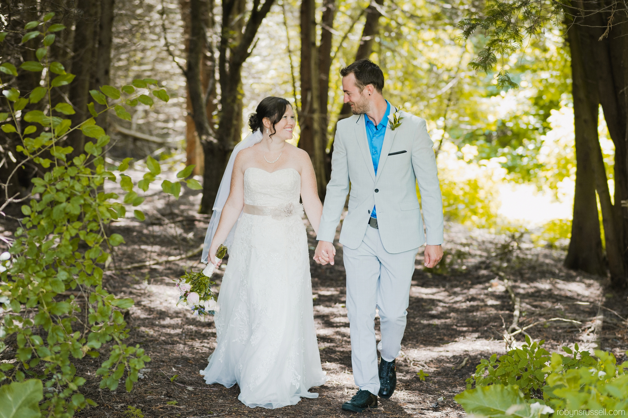 34-bride-and-groom-walking-from-forest.jpg