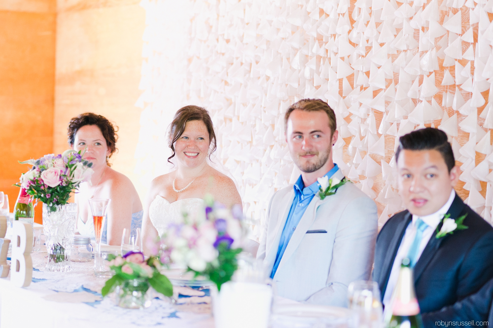 48-bride-and-groom-with-bridal-party-at-dinner.jpg