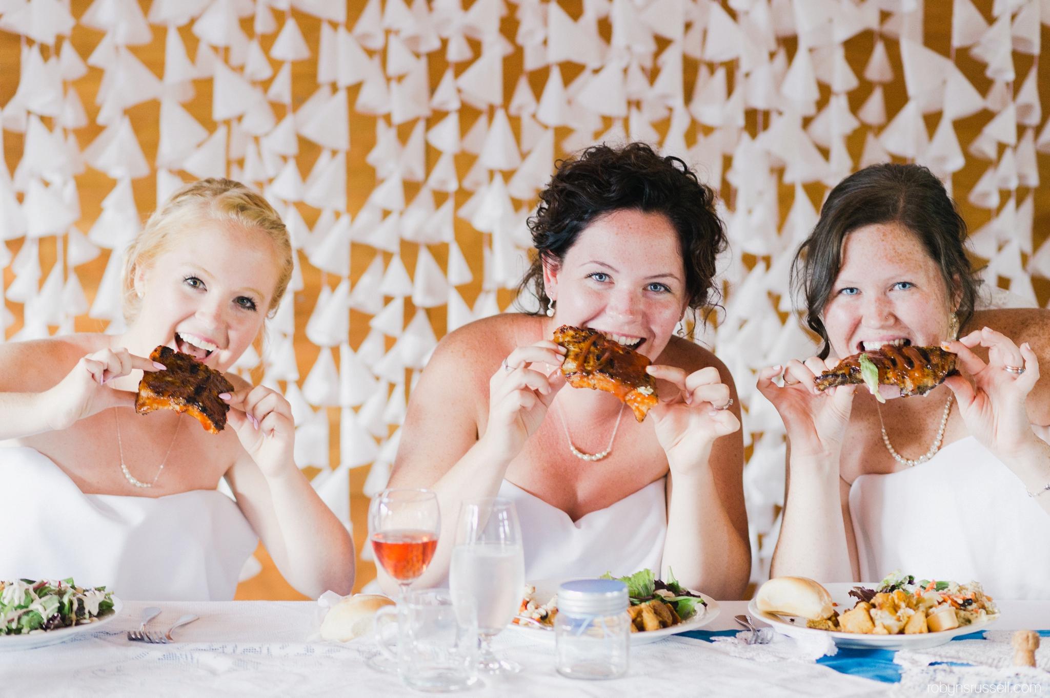 49-bride-and-bridesmaids-eating-ribs.jpg